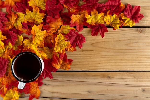 Tea cup with autumn leaves Free Photo