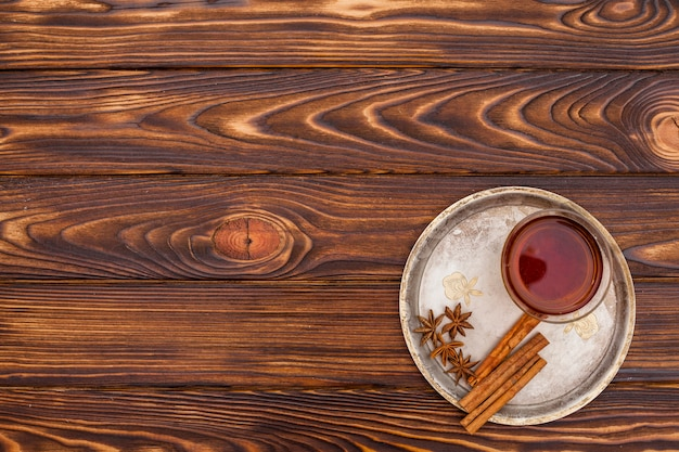 Tea cup with cinnamon and anise on plate Free Photo