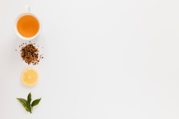 Tea cup with lemon slice and copy space Free Photo