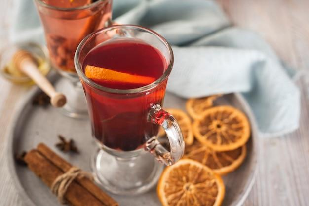 Tea cup with orange slices and cinnamon Free Photo