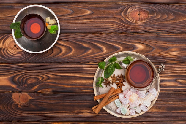 Tea cup with turkish delight on big plate Free Photo