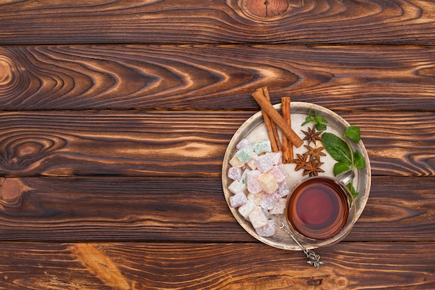 Tea cup with turkish delight on plate Free Photo
