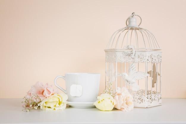 Tea next to elegant decorations Free Photo