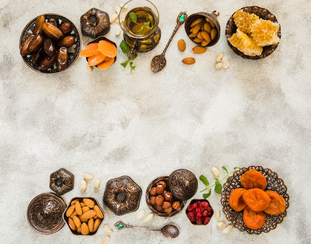 Tea glass with different dried fruits and nuts Photo | Free
