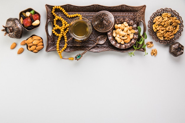 Tea glass with different nuts and beads Free Photo