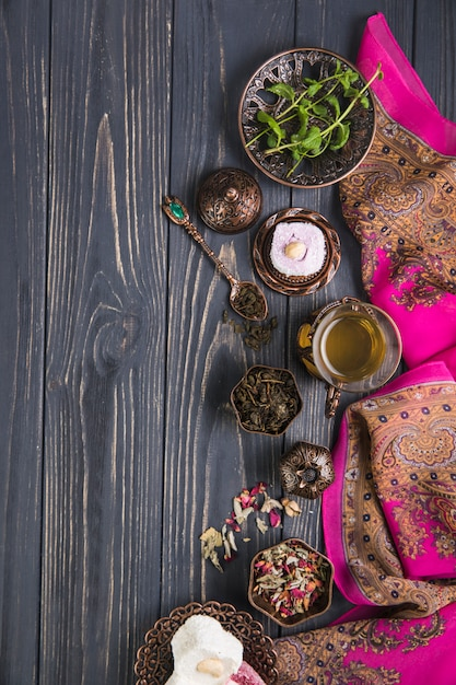Tea glass with turkish delight and herbs Free Photo