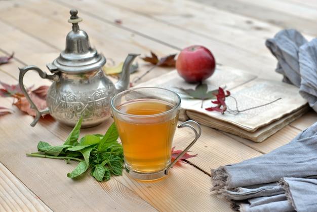 Tea mint on a mug in garden Premium Photo