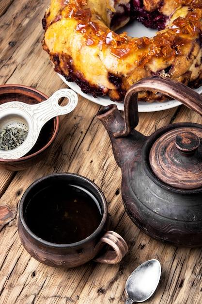 Tea-party with rustic pie Premium Photo