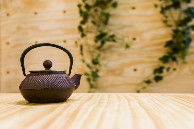 Tea pot in a table Free Photo