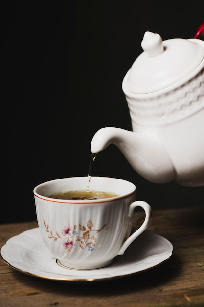 Tea pouring into cup Photo   Free Download