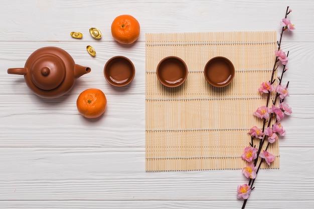 Tea set and sakura branch Free Photo