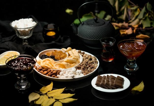 Tea set made of chocolate jam and dried fruits Free Photo