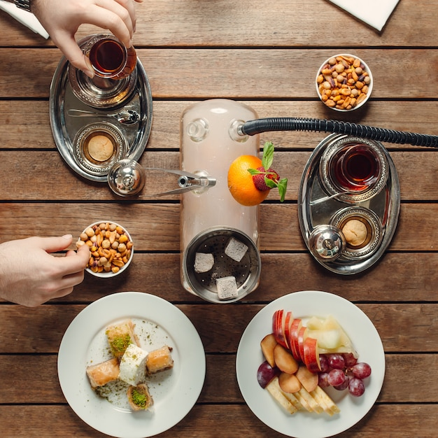 Tea set with snacks sweets and fruits top view Free Photo