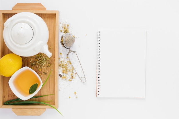 Tea tray with notebook mock-up Free Photo