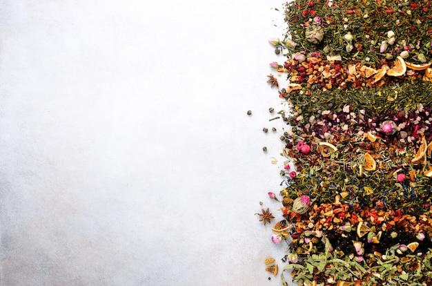Tea types: green, black, floral, herbal, mint, melissa, ginger, apple, rose, lime tree, fruits, orange, hibiscus, raspberry, cornflower, cranberry Premium Photo