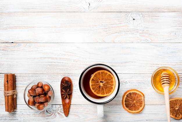 Tea with orange, honey and copy space Free Photo