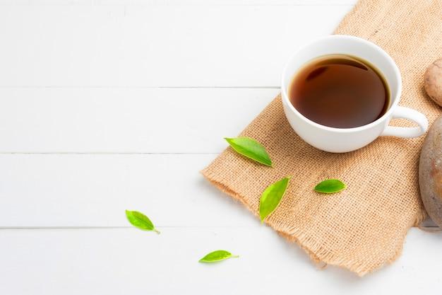 Tea with tea glass on white wood Premium Photo