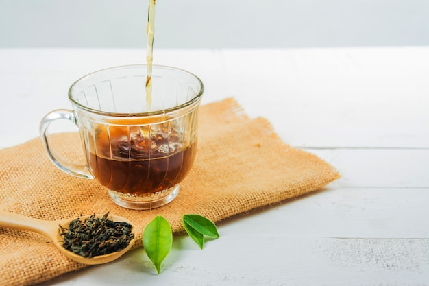 Tea with  tea glass on white wood Premium Photo