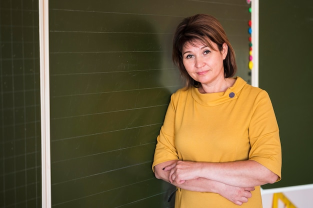 Teacher with arms crossed Free Photo