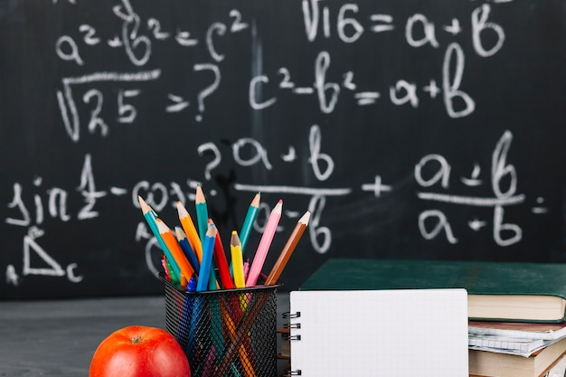 Teacher workplace with different stationery Free Photo