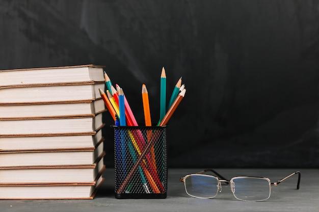Teachers supplies at table Free Photo