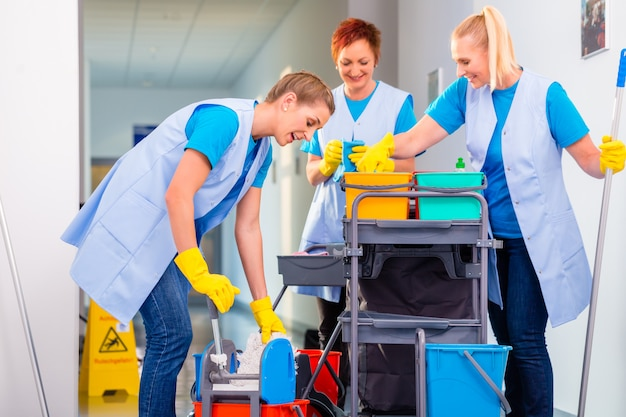 Team of cleaning ladies working Premium Photo