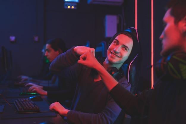 Team of computer gamers celebrating win Premium Photo