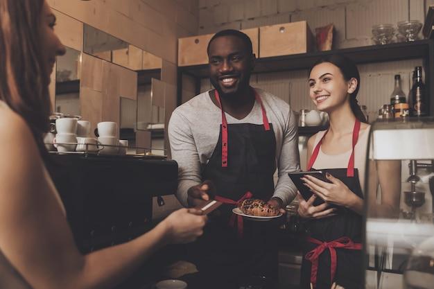 Team of male and female barista service customer Premium Photo