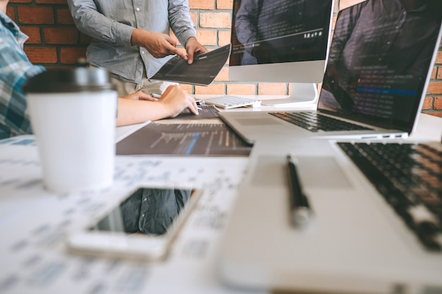 Team of professional developer programmer cooperation meeting and brainstorming and programming in website working a software and coding technology, writing codes and database Premium Photo