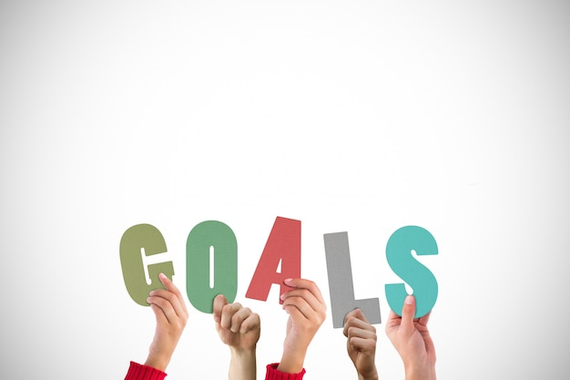 Team together creating the word goals Free Photo