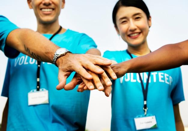 Team of volunteers stacking hands Free Photo