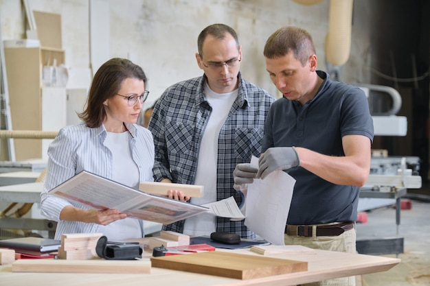 Team of woodworking workshop workers are discussing. Premium Photo