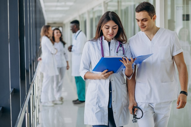 Team of young specialist doctors standing in the corridor of the hospital Free Photo