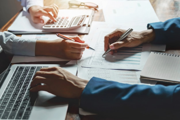 Teamwork business working on desk accounting concept financial in office Premium Photo