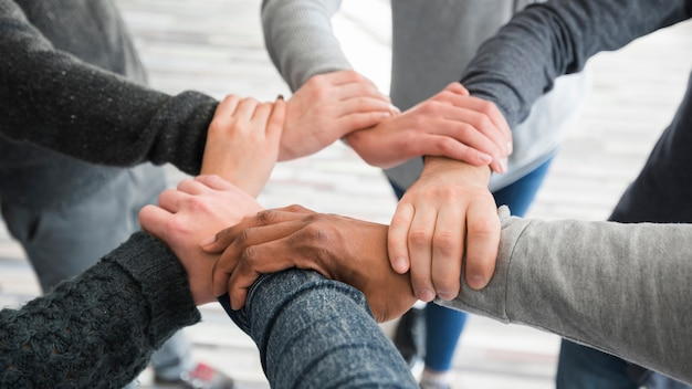 Teamwork concept with hands of group of people Premium Photo