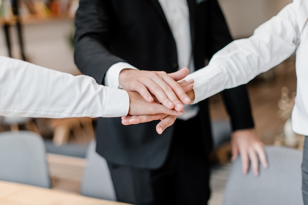 Teamwork with hands together Premium Photo