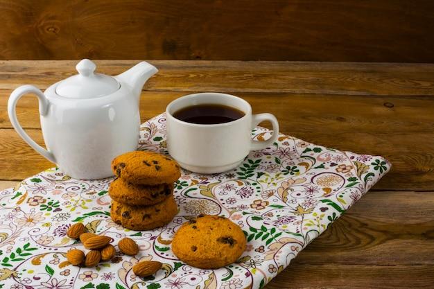 Teapot and cup of tea Premium Photo