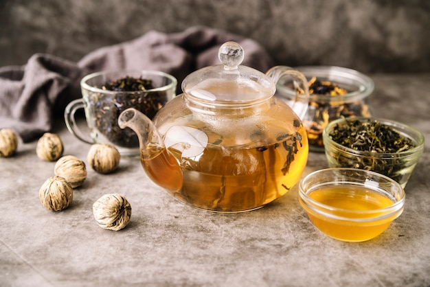 Teapot and cups with walnuts high view Free Photo