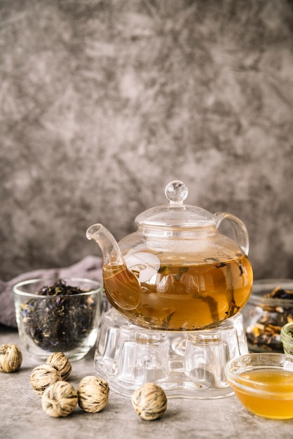 Teapot filled and walnuts on marble background Free Photo