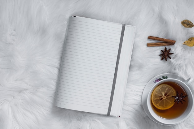 Teatime with opened blank notebook Free Photo
