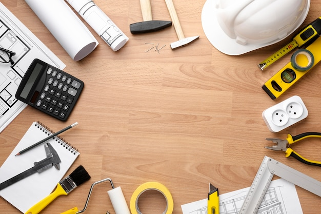 Technical plan drawing with wooden copy space background Premium Photo