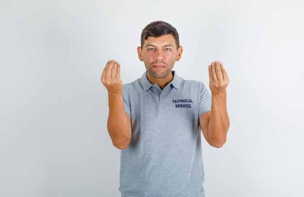 Technical service man doing italian gesture with hands in grey t-shirt and looking confident Free Photo