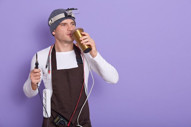 Technician having rest after repairing computer hardware in lab Free Photo