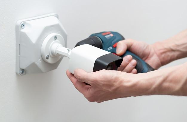 Technician installing cctv camera video security Premium Photo