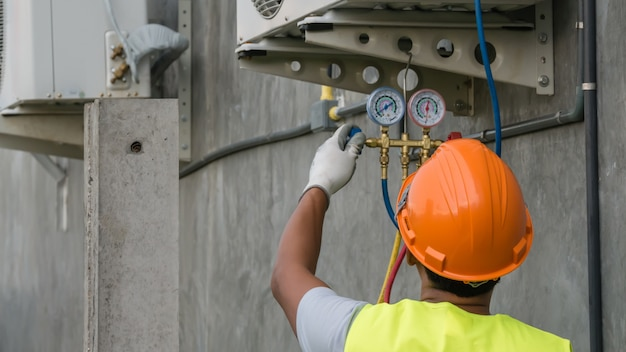 Technician is checking air conditioner Premium Photo