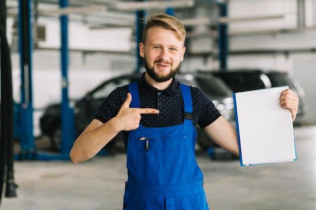 Technician pointing on folder Free Photo