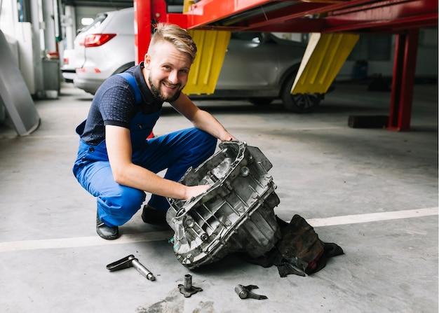 Technician repairing engine Free Photo