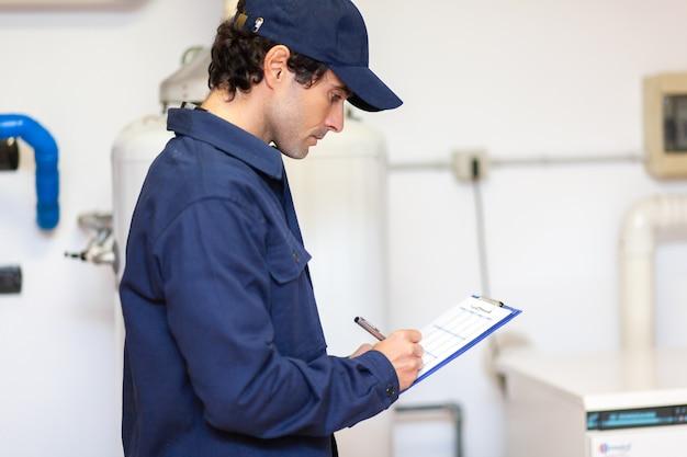 Technician servicing an hot-water heater Premium Photo