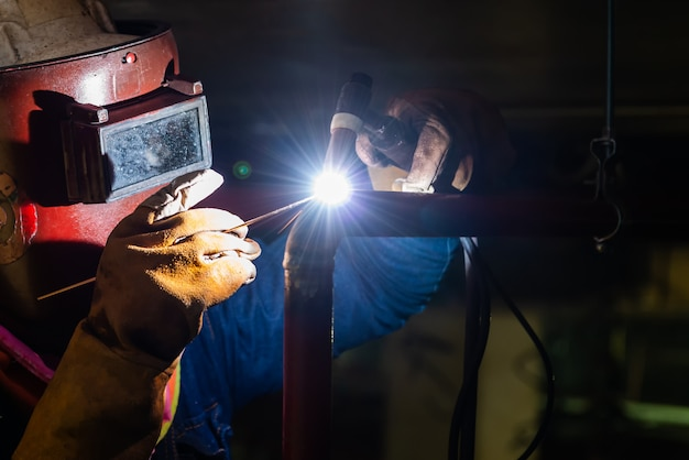 Technician welder steel with gas in the manufacturing area Premium Photo