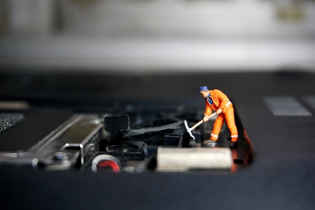 Technician worker figure standing on a old usb flash drive. it support concept. Premium Photo